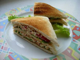 Crab and smoked salmon club sandwiches